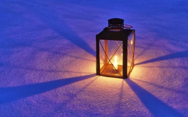 candela-di-natale-accesa